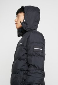 Calvin Klein Jeans - HOODED DOWN PUFFER  - Winter jacket - black - 6