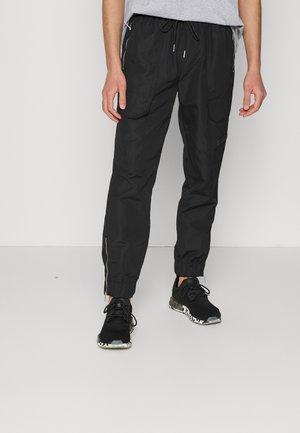 MERV WATERPROOF UNISEX - Cargo trousers - black