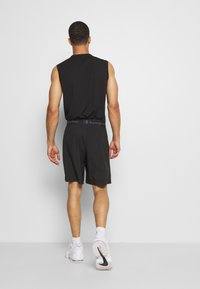 Champion - LEGACY TRAINING BERMUDA - Urheilushortsit - black - 2