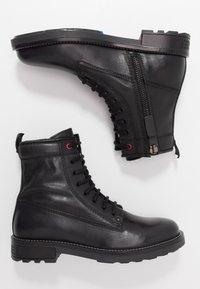Diesel - D-THROUPER DBB Z - Lace-up ankle boots - black - 1