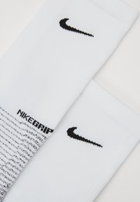 Nike Performance - GRIP STRIKE - Sports socks - white/black - 2