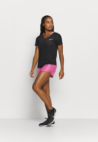 Nike Performance - RUN SHORT - Pantalón corto de deporte - pink glow/white - 1