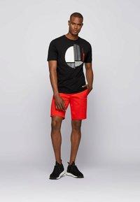 BOSS - Print T-shirt - black - 1