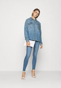 Vero Moda - VMMINA LOOSE - Button-down blouse - medium blue denim - 1