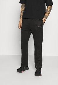 9N1M SENSE - LOGO PANTS UNISEX - Pantalon de survêtement - black - 0