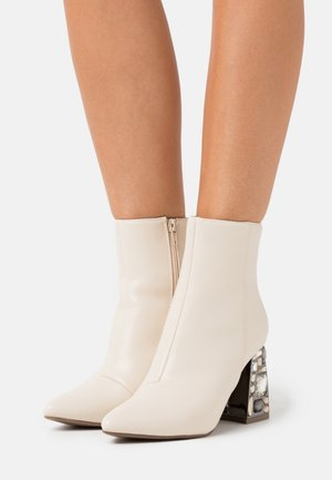 High heeled ankle boots - white