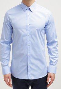HUGO - ELISHA EXTRA SLIM FIT - Formal shirt - light/pastel blue - 4