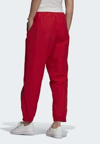 adidas Originals - PAOLINA RUSSO ADICOLOR SPORTS INSPIRED MID RISE PANTS - Tracksuit bottoms - scarlet - 1