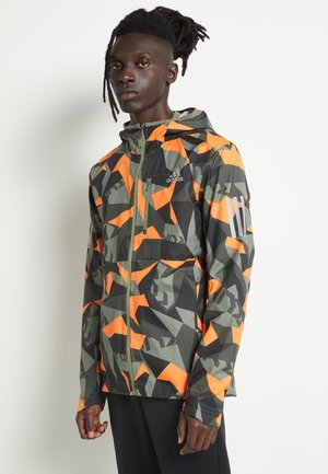 OWN THE RUN - Laufjacke - legacy greepp signal orange/black