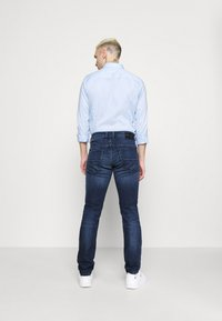 Diesel - THOMMER - Slim fit jeans - dark blue - 2