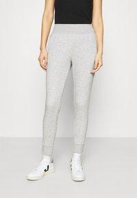 CALANDO - Pantalones deportivos - mottled light grey - 0