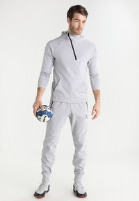 Erima - ESSENTIAL  - Tracksuit bottoms - light grey melange/black - 1