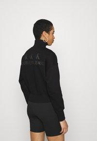 Calvin Klein Jeans - BACK REFLECTIVE LOGO HALF ZIP - Sweatshirt - black - 2