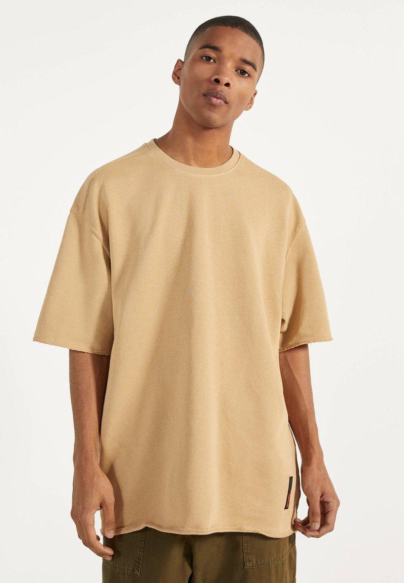 Bershka - Jednoduché triko - beige