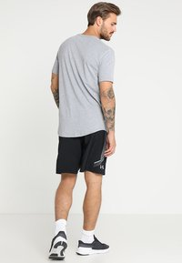 Under Armour - GRAPHIC SHORTS - Urheilushortsit - black/steel - 2