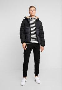 TOM TAILOR DENIM - HEAVY PUFFER JACKET - Winter jacket - grey - 1