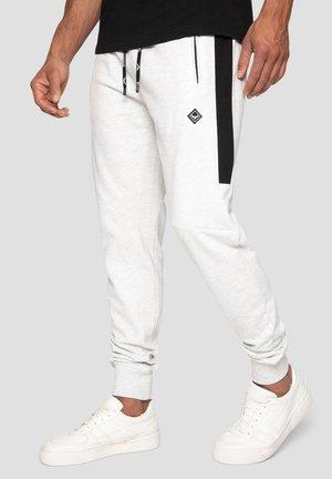 KELVIN - Pantalon de survêtement - ecru space dye