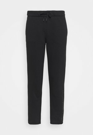 SHINY RAISED PANT - Pantalon de survêtement - black
