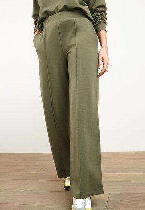 LOUNGE - Trousers - khaki