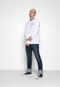 Tommy Jeans - SCANTON SLIM - Slim fit jeans - queens dark blue - 1