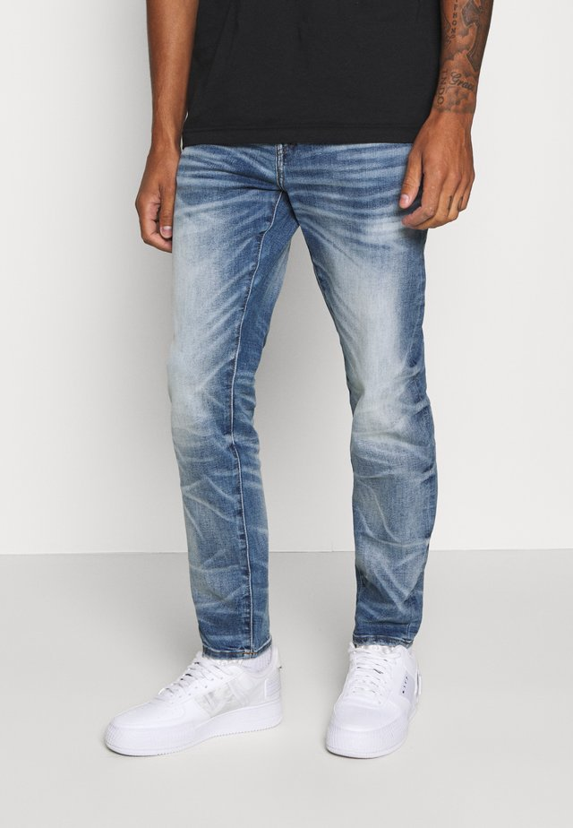 MEDIUM WASH ATHLETIC - Jeans fuselé - worn out blue
