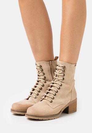 CASIO - Lace-up ankle boots - arena