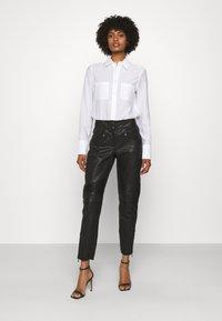 Belstaff - FREYA TROUSER - Leather trousers - black - 1