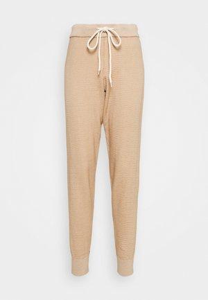 ALICE - Teplákové kalhoty - praline ivory