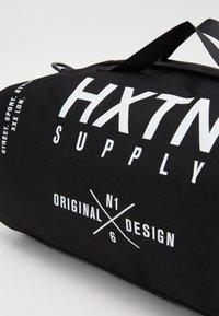 HXTN Supply - BLACK HEIST BAG - Sports bag - black - 4