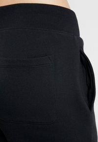 Champion - CUFF PANTS - Træningsbukser - black - 3