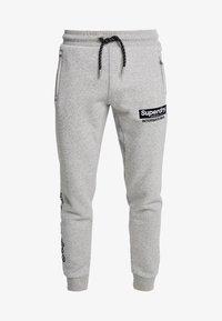 Superdry - INTERNATIONAL APPLIQUE JOGGER - Pantalones deportivos - silver glass feeder - 4
