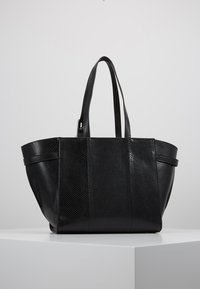 Calvin Klein - WINGED MED - Handbag - black - 2