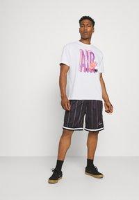 Nike Sportswear - TEE AIR LOOSE FIT - T-shirt med print - white - 1