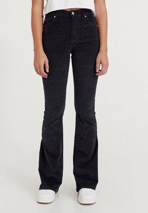 Flared Jeans - mottled black
