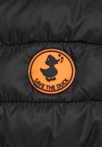Save the duck - ANITA - Chaleco - black - 2