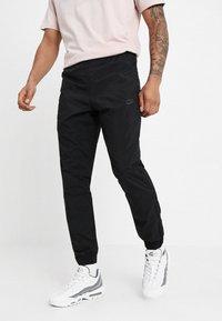 Nike Sportswear - WOVEN PANT - Tracksuit bottoms - black/anthracite/dark grey - 0
