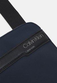 Calvin Klein - FLAT PACK UNISEX - Across body bag - blue - 3