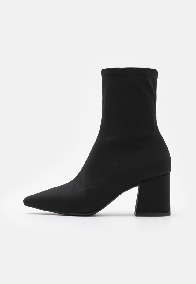 POINTED TOE MID HEEL SOCK BOOT - Stivaletti - black