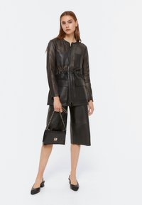 Uterqüe - 00665551 - Leather jacket - black - 1