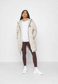 Jordan - ESSENTIAL - Leggings - Trousers - mahogany/gold - 1