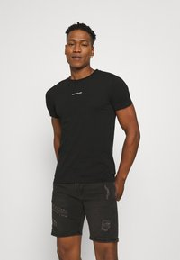 Calvin Klein Jeans - MICRO BRANDING ESSENTIAL TEE - T-shirt basic - black - 0