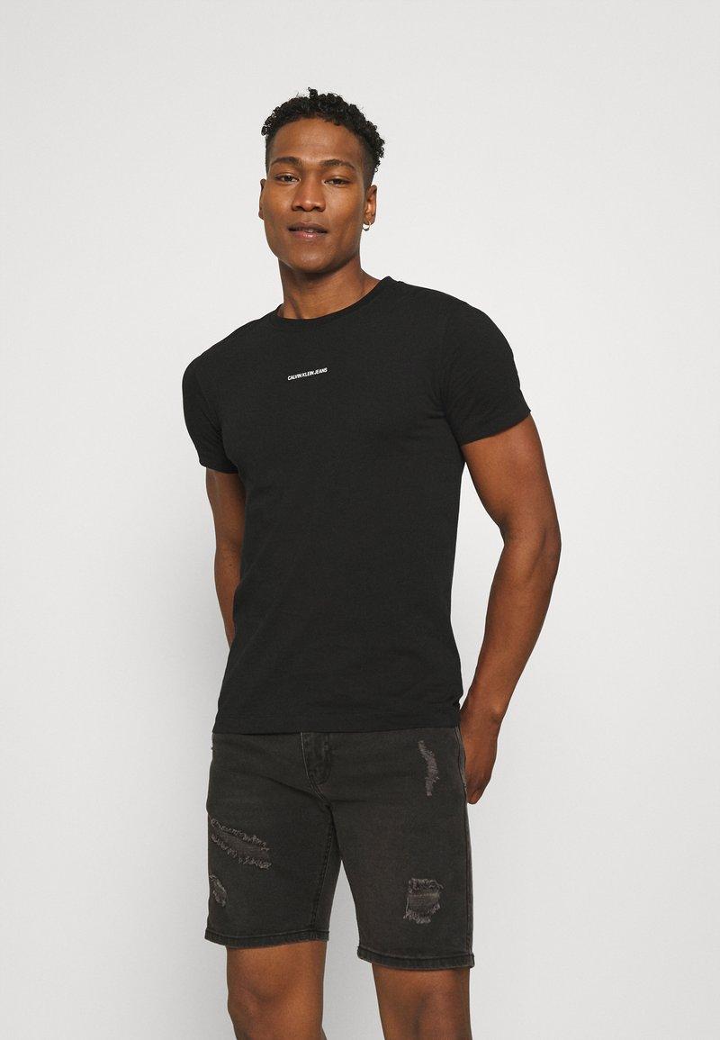 Calvin Klein Jeans - MICRO BRANDING ESSENTIAL TEE - T-shirt basic - black