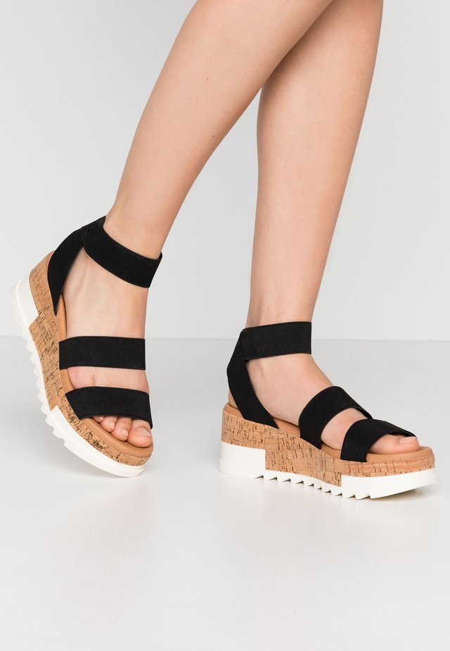BANDI - Platform sandals - black