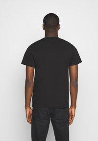Calvin Klein Jeans - ACID WASH TEE - Basic T-shirt - black - 2