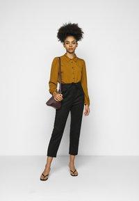 ONLY Petite - ONLPOPTRASH EASY PANT - Trousers - black - 1