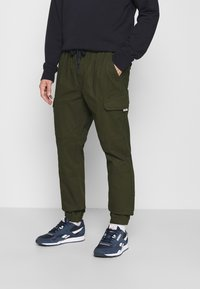 Tommy Jeans - JOGGER - Cargo trousers - dark olive - 0