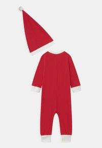 Lindex - ONESIE SANTA UNISEX - Pyjamas - red - 1