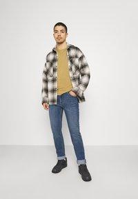 Lee - RIDER - Jeans slim fit - blue denim - 1