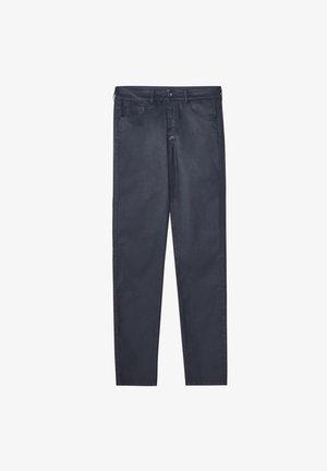 MIT GUMMIERTEM FINISH - Jeans Skinny - dark blue