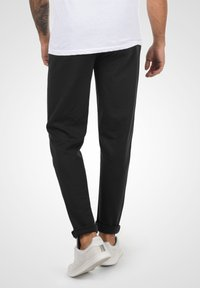 Solid - Trousers - black